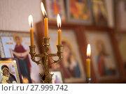 Купить «candle against the background of orthodox icons», фото № 27999742, снято 1 февраля 2018 г. (c) Типляшина Евгения / Фотобанк Лори