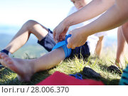 Купить «mother provides children knee elastic bandage.», фото № 28006370, снято 23 февраля 2018 г. (c) PantherMedia / Фотобанк Лори