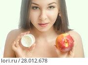 Купить «young girl with a peach and cream», фото № 28012678, снято 22 марта 2019 г. (c) PantherMedia / Фотобанк Лори