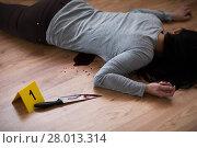 Купить «dead woman body lying on floor at crime scene», фото № 28013314, снято 5 мая 2017 г. (c) Syda Productions / Фотобанк Лори
