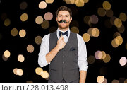 Купить «happy young man with fake mustache at party», фото № 28013498, снято 15 декабря 2017 г. (c) Syda Productions / Фотобанк Лори