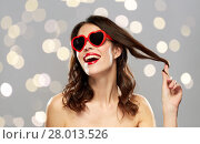 Купить «woman with red lipstick and heart shaped shades», фото № 28013526, снято 5 января 2018 г. (c) Syda Productions / Фотобанк Лори