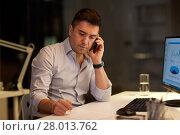 Купить «businessman calling on sartphone at night office», фото № 28013762, снято 6 декабря 2017 г. (c) Syda Productions / Фотобанк Лори