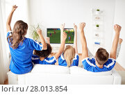 Купить «football fans watching soccer game on tv at home», фото № 28013854, снято 14 августа 2016 г. (c) Syda Productions / Фотобанк Лори
