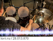 Купить «drummer playing drum kit at sound recording studio», фото № 28013870, снято 18 августа 2016 г. (c) Syda Productions / Фотобанк Лори