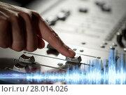 Купить «hand using mixing console for music recording», фото № 28014026, снято 18 августа 2016 г. (c) Syda Productions / Фотобанк Лори