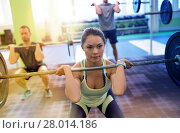 Купить «group of people training with barbells in gym», фото № 28014186, снято 19 февраля 2017 г. (c) Syda Productions / Фотобанк Лори