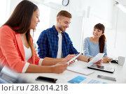 Купить «happy creative team or students working at office», фото № 28014218, снято 27 февраля 2016 г. (c) Syda Productions / Фотобанк Лори