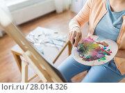 Купить «artist with palette knife painting at art studio», фото № 28014326, снято 1 июня 2017 г. (c) Syda Productions / Фотобанк Лори