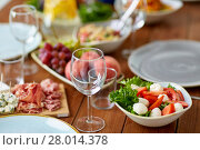 Купить «vegetable salad with mozzarella on wooden table», фото № 28014378, снято 5 октября 2017 г. (c) Syda Productions / Фотобанк Лори