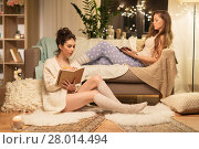 Купить «happy female friends with book and diary at home», фото № 28014494, снято 21 января 2018 г. (c) Syda Productions / Фотобанк Лори