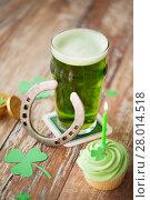 Купить «glass of beer, cupcake, horseshoe and gold coins», фото № 28014518, снято 31 января 2018 г. (c) Syda Productions / Фотобанк Лори