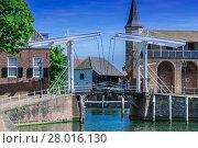 Купить «double drawbridge in holland ziereksee.», фото № 28016130, снято 22 октября 2018 г. (c) PantherMedia / Фотобанк Лори