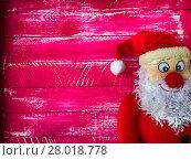 Купить «Christmas Santa Claus on a background of wooden pink variegated surface», фото № 28018778, снято 21 августа 2018 г. (c) PantherMedia / Фотобанк Лори