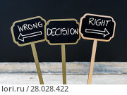 Купить «Concept message WRONG DECISION RIGHT DECISION written with chalk», фото № 28028422, снято 22 мая 2018 г. (c) PantherMedia / Фотобанк Лори
