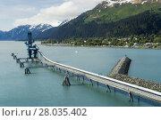 Купить «Industiral Pipe at the port of Seward delivering oil from Trans-Alaska Oil System», фото № 28035402, снято 16 июня 2019 г. (c) PantherMedia / Фотобанк Лори