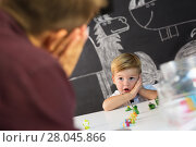 Купить «Cute little toddler boy at child therapy session.», фото № 28045866, снято 18 июля 2018 г. (c) Matej Kastelic / Фотобанк Лори