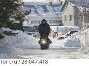 Купить «Compact snowmobile - motorcycle towing pulls cargo on snow countryside», фото № 28047418, снято 17 февраля 2018 г. (c) Константин Шишкин / Фотобанк Лори