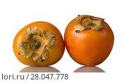 Купить «Sweet, vitaminized persimmon fruit isolated on white», фото № 28047778, снято 20 декабря 2017 г. (c) Сергей Молодиков / Фотобанк Лори