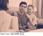 Купить «Young couple meeting financial adviser at home», фото № 28048022, снято 20 февраля 2019 г. (c) Яков Филимонов / Фотобанк Лори