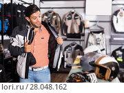 Купить «customer is trying up modern jacket», фото № 28048162, снято 1 сентября 2017 г. (c) Яков Филимонов / Фотобанк Лори