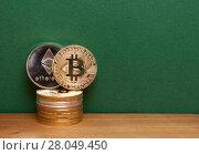 Golden bitcoin andethereum coins. Стоковое фото, фотограф Anton Chechotkin / Фотобанк Лори