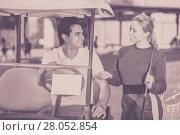 Купить «Glad man and woman golfers riding golf cart», фото № 28052854, снято 22 августа 2018 г. (c) Яков Филимонов / Фотобанк Лори