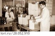 Купить «Man standing in packing section on winemaking factory», фото № 28052910, снято 21 сентября 2016 г. (c) Яков Филимонов / Фотобанк Лори