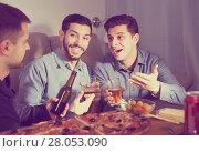 Купить «Three men talking and laughing at home», фото № 28053090, снято 10 января 2018 г. (c) Яков Филимонов / Фотобанк Лори