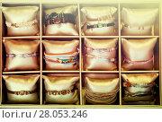 Купить «bracelets in bijouterie store», фото № 28053246, снято 19 сентября 2018 г. (c) Яков Филимонов / Фотобанк Лори