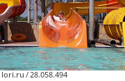 Купить «Grandpa with grandson sliding on water slide in water park», видеоролик № 28058494, снято 6 июня 2014 г. (c) Алексей Кузнецов / Фотобанк Лори