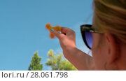 Купить «Woman playing with yellow fidget spinner outdoor», видеоролик № 28061798, снято 10 декабря 2018 г. (c) Данил Руденко / Фотобанк Лори