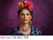 Купить «Beautiful young woman with flowers and beads», фото № 28067706, снято 17 февраля 2018 г. (c) Алексей Кузнецов / Фотобанк Лори