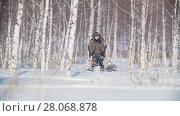 Купить «Man overcoming deep snow on a mini snowmobile in the snowy forest», видеоролик № 28068878, снято 19 марта 2018 г. (c) Константин Шишкин / Фотобанк Лори