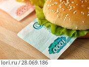 Купить «Burgers with one thousand and five thousand rubles bills», фото № 28069186, снято 11 февраля 2018 г. (c) Георгий Дзюра / Фотобанк Лори