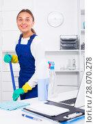 Купить «Woman cleaning at company office», фото № 28070278, снято 7 августа 2020 г. (c) Яков Филимонов / Фотобанк Лори