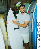 Купить «male surfer holding professional surfboard», фото № 28070606, снято 22 августа 2017 г. (c) Яков Филимонов / Фотобанк Лори