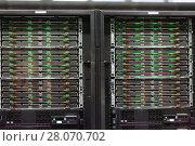 Купить «Closeup of hardware of data center», фото № 28070702, снято 15 января 2018 г. (c) Яков Филимонов / Фотобанк Лори