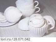 Купить «Кондитерские изделия, еда, десерт. Белый сладкий зефир на светлом фоне. Confectionery, food, dessert. White sweet marshmallows on a light background», фото № 28071042, снято 18 февраля 2018 г. (c) Светлана Евграфова / Фотобанк Лори
