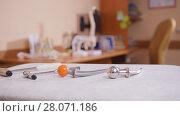 Купить «The cabinet of neurologist, medical tools in the foreground, models of skeletons on the table», фото № 28071186, снято 25 марта 2018 г. (c) Константин Шишкин / Фотобанк Лори