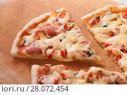 pizza on a wooden background. Стоковое фото, фотограф Myroslav Kuchynskyi / Фотобанк Лори