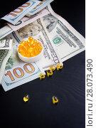 Купить «Capsules of fish oil and dollars on black background», фото № 28073490, снято 18 февраля 2018 г. (c) Papoyan Irina / Фотобанк Лори
