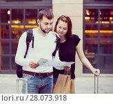 Купить «Portrait of couple with map and baggage», фото № 28073918, снято 25 мая 2017 г. (c) Яков Филимонов / Фотобанк Лори