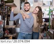 Купить «couple in antique furnishings store», фото № 28074094, снято 9 ноября 2017 г. (c) Яков Филимонов / Фотобанк Лори