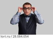 Купить «frightened nerd in spectacles and bow tie», фото № 28084054, снято 18 февраля 2018 г. (c) Александр Лычагин / Фотобанк Лори