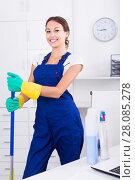 Купить «Woman cleaning at company office», фото № 28085278, снято 21 июля 2018 г. (c) Яков Филимонов / Фотобанк Лори