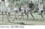 Купить «Two friendly families with children playing football in nature at summer», фото № 28085502, снято 23 августа 2017 г. (c) Яков Филимонов / Фотобанк Лори