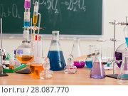 Купить «Glass flasks with multi-colored liquids at the chemistry lesson», фото № 28087770, снято 17 февраля 2018 г. (c) Майя Крученкова / Фотобанк Лори