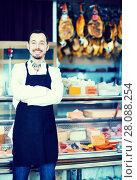 Купить «Seller offering displayed sorts of meat», фото № 28088254, снято 2 января 2017 г. (c) Яков Филимонов / Фотобанк Лори
