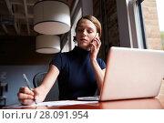 Купить «Businesswoman Working On Laptop And Making Phone Call», фото № 28091954, снято 3 сентября 2016 г. (c) easy Fotostock / Фотобанк Лори